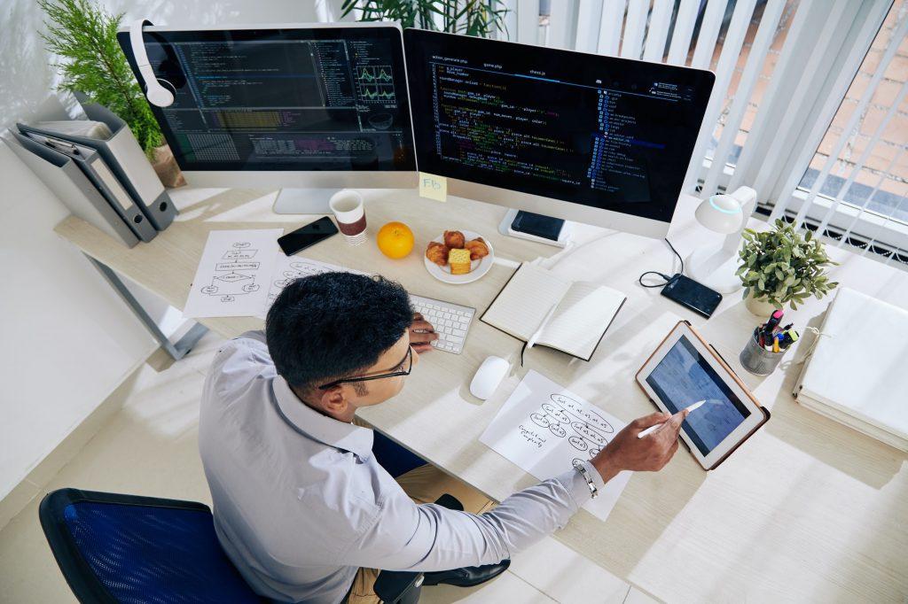 Software developer checking calendar